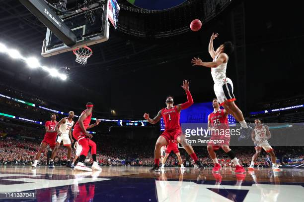 Kihei Clark of the Virginia Cavaliers attempts a shot against the Texas Tech Red Raiders in the first half during the 2019 NCAA men's Final Four...