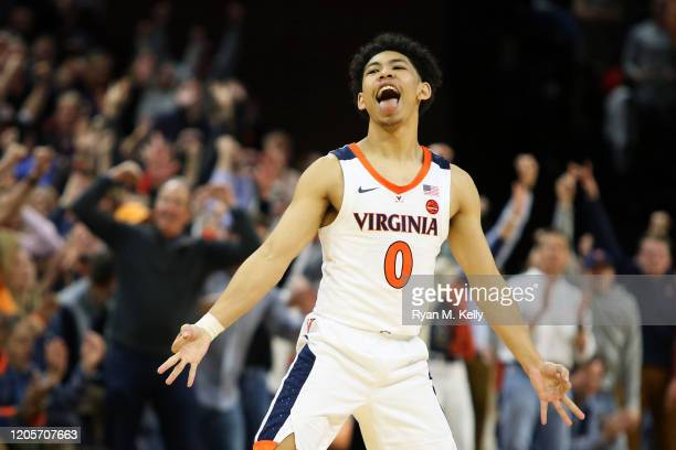 Kihei Clark of the Virginia Cavaliers celebrates making a threepoint shot in the second half during a game against the Louisville Cardinals at John...