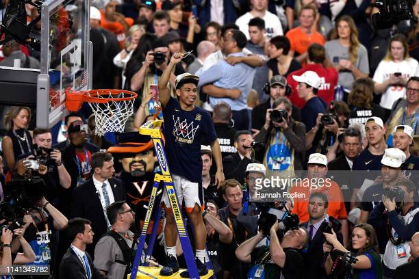 Kihei Clark of the Virginia Cavaliers cuts down the net after his teams 8577 win over the Texas Tech Red Raiders during the 2019 NCAA men's Final...