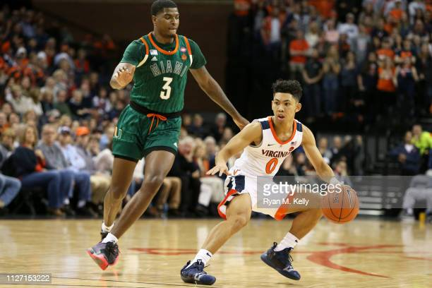 Kihei Clark of the Virginia Cavaliers drives past Anthony Lawrence II of the Miami Hurricanes in the second half during a game at John Paul Jones...