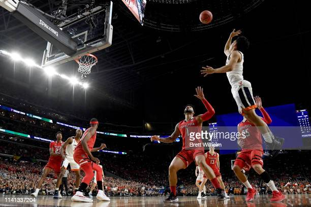 Kihei Clark of the Virginia Cavaliers is defended by Brandone Francis of the Texas Tech Red Raiders during the first half in the 2019 NCAA men's...
