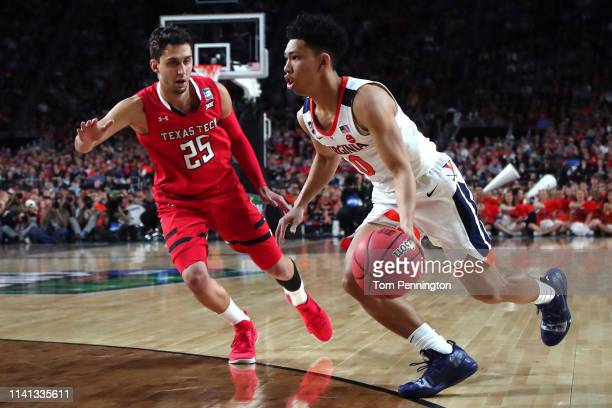 Kihei Clark of the Virginia Cavaliers is defended by Davide Moretti of the Texas Tech Red Raiders in the first half during the 2019 NCAA men's Final...