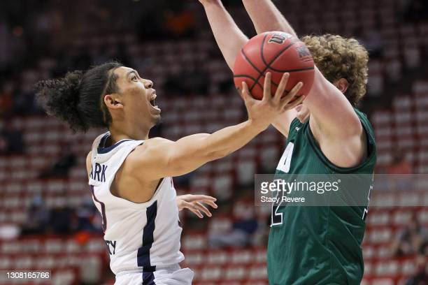 Kihei Clark of the Virginia Cavaliers is fouled by Colin Granger of the Ohio Bobcats in the first round game of the 2021 NCAA Men's Basketball...