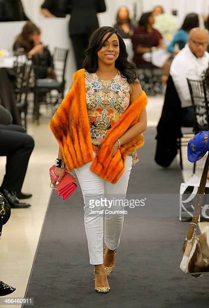 Kijafa Vick walks the runway at the Saks Fifth Avenue And Off The Field Players' Wives Association Charitable Fashion Show on January 31 2014 in New...