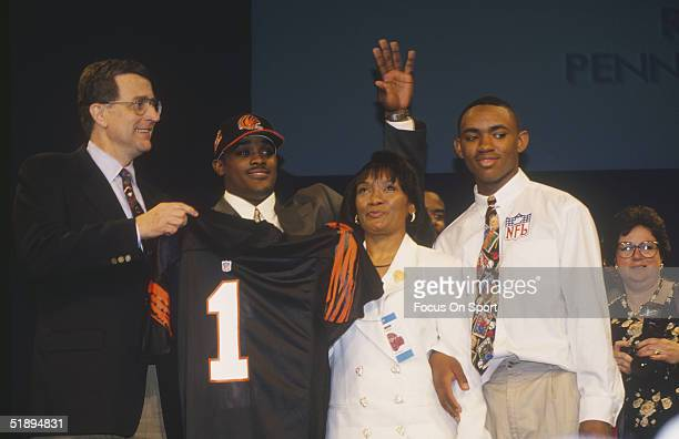 KiJana Carter poses with his family and his new team jersey for the Cincinnati Bengals player during the 1995 NFL Draft