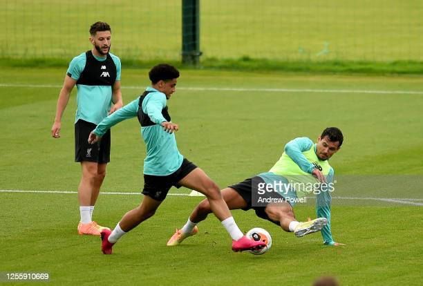 KiJana Hoever and Dejan Lovren of Liverpool during a training session at Melwood Training Ground on July 13 2020 in Liverpool England