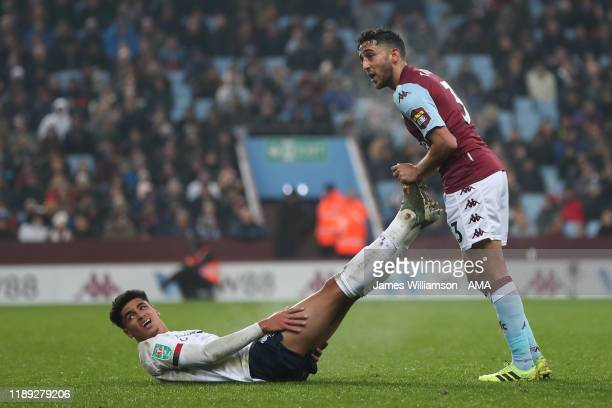 Ki-Jana Hoever of Liverpool and Neil Taylor of Aston Villa during the Carabao Cup Quarter Final match between Aston Villa and Liverpool FC at Villa...