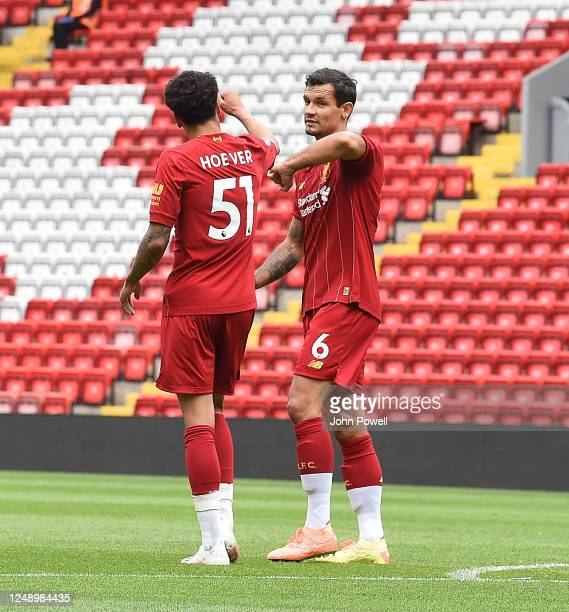 KiJana Hoever of Liverpool celabrates with Dejan Lovren of Liverpool after Hoever goal during the game at Anfield on June 11 2020 in Liverpool England