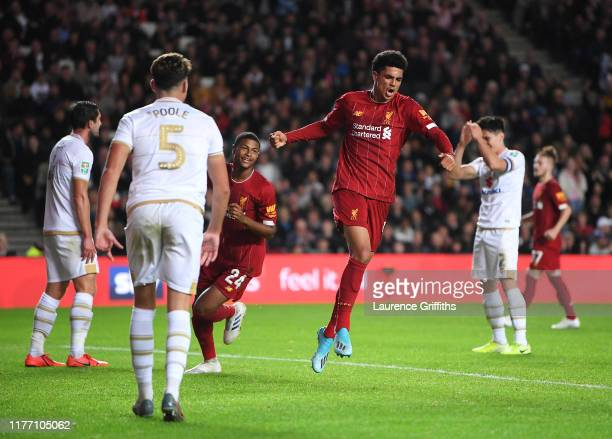 KiJana Hoever of Liverpool celebrates after he scores his sides second goal during the Carabao Cup Third Round match between Milton Keynes Dons and...