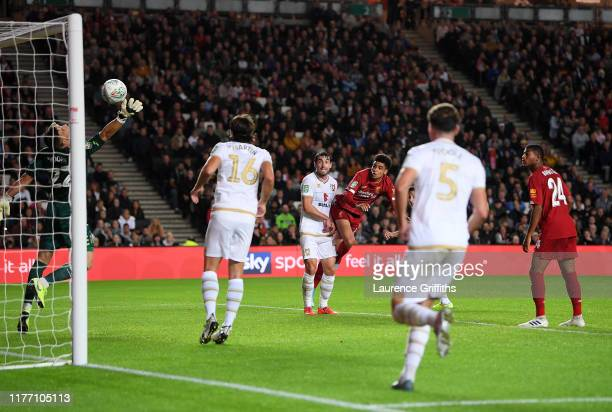 KiJana Hoever of Liverpool scores his sides second goal during the Carabao Cup Third Round match between Milton Keynes Dons and Liverpool FC at...