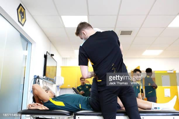 Ki-Jana Hoever of Wolverhampton Wanderers has his measurements taken by Ollie Leaper, Physio of Wolverhampton Wanderers as part of physio screening...