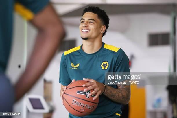 Ki-Jana Hoever of Wolverhampton Wanderers shoots the basketball at Sir Jack Hayward Training Ground as Wolverhampton Wanderers Pre-Season commences...