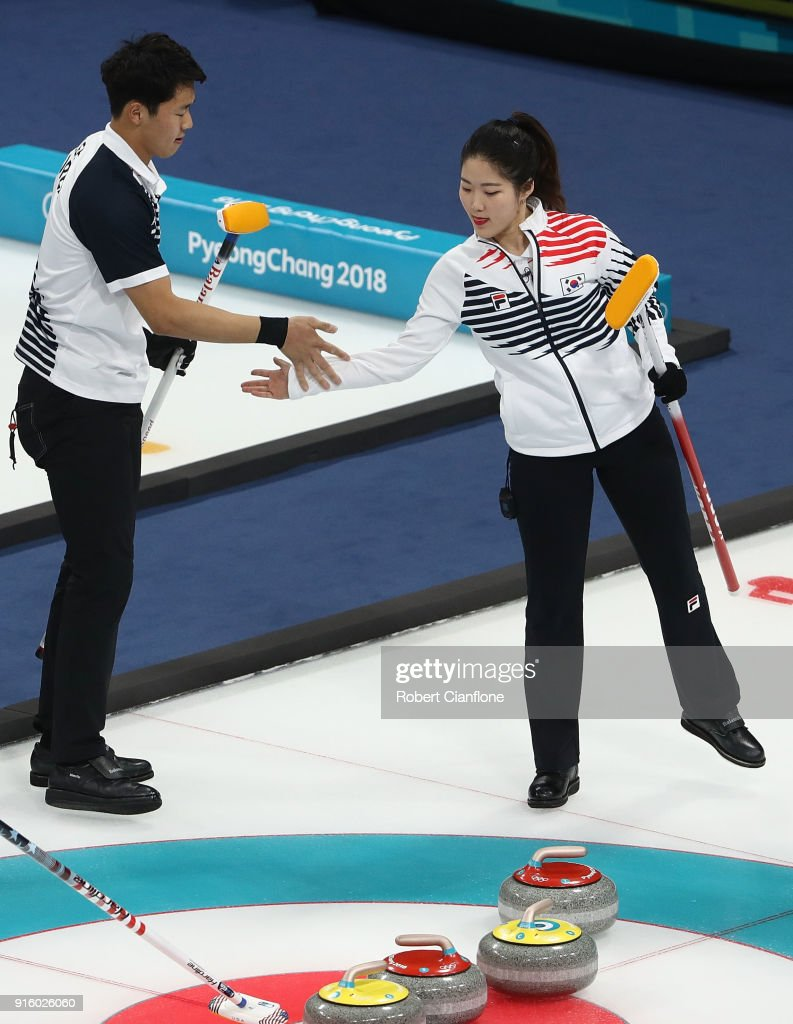 Kijeong Lee and Hyeji Jang of Korea celebrate during the Curling Mixed Doubles Round Robin match ahead of the PyeongChang 2018 Winter Olympic Games at Gangneung Curling Centre on February 9, 2018 in Gangneung, South Korea.