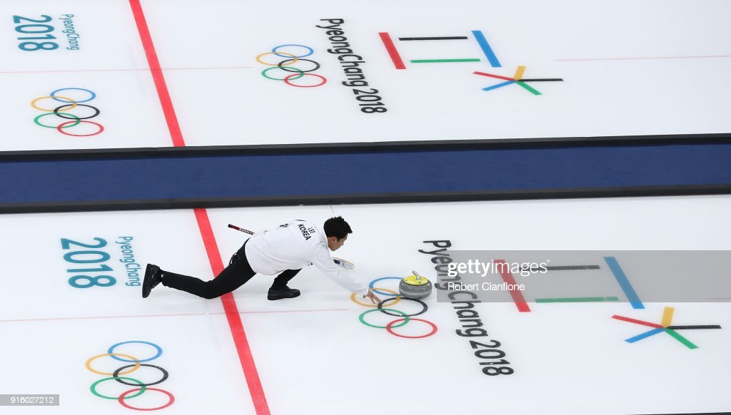 Kijeong Lee of Kore delivers a stone during the Curling Mixed Doubles Round Robin match ahead of the PyeongChang 2018 Winter Olympic Games at Gangneung Curling Centre on February 9, 2018 in Gangneung, South Korea.