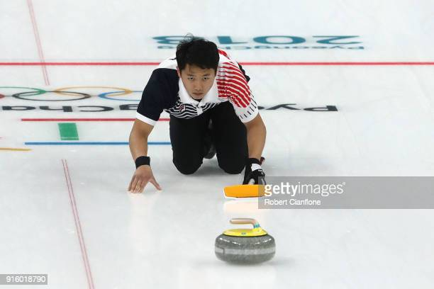 Kijeong Lee of Korea delivers a stone against Becca Hamilton and Matt Hamilton of the United States during the Curling Mixed Doubles Round Robin...