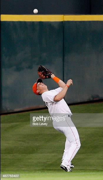 Kik Hernandez of the Houston Astros positions himself under a deep fly ball hit by Garrett Jones of the Miami Marlins at Minute Maid Park on July 26...