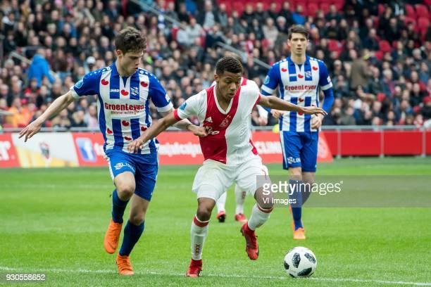 Kik Pierie of sc Heerenveen David Neres of Ajax during the Dutch Eredivisie match between Ajax Amsterdam and sc Heerenveen at the Amsterdam Arena on...
