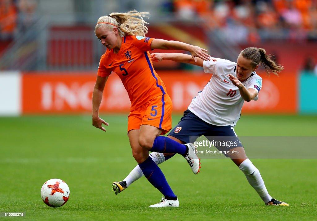 Kika van Es of the Netherlands is tackled by Caroline Graham Hansen of Norway during the Group A match between Netherlands and Norway during the UEFA Women's Euro 2017 at Stadion Galgenwaard on July 16, 2017 in Utrecht, Netherlands.
