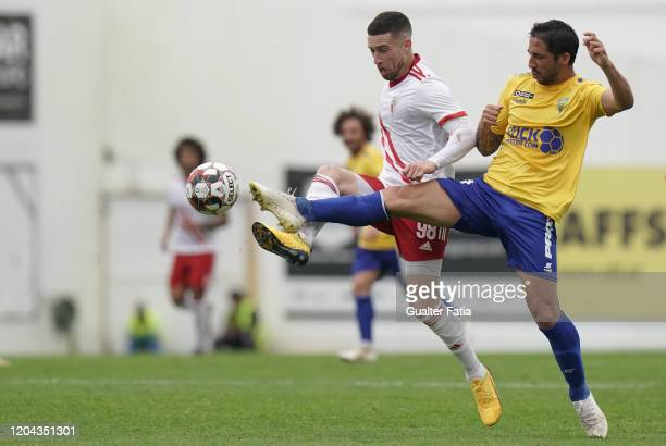 Kikas of UD Vilafranquense with Joao Diogo of GD Estoril Praia in action during the Liga Pro match between GD Estoril Praia and UD Vilafranquense at...