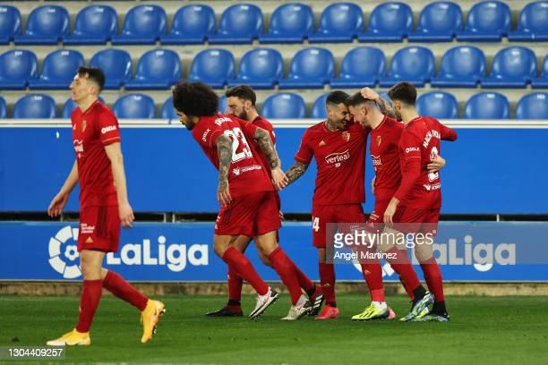 Kike Barja of CA Osasuna celebrates with teammates after scoring his team's first goal during the La Liga Santander match between Deportivo Alaves...