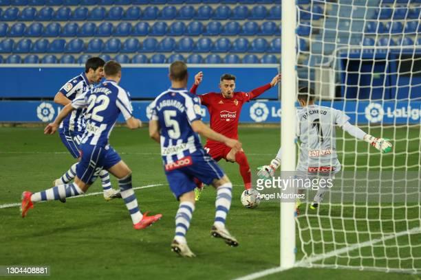 Kike Barja of CA Osasuna scores his team's first goal past Fernando Pacheco Flores of Deportivo Alaves during the La Liga Santander match between...