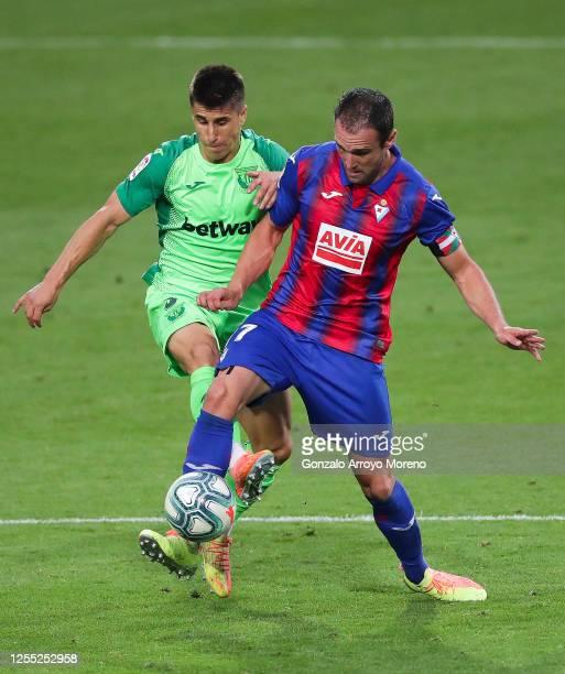 Kike Garcia of SD Eibar competes for the ball with Unai Bustinza of CD Leganes during the Liga match between SD Eibar SAD and CD Leganes at Ipurua...