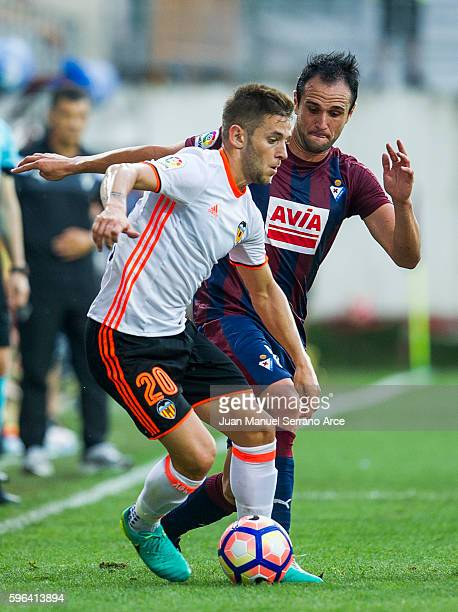 Kike Garcia of SD Eibar duels for the ball with Alvaro Medran of Valencia CF during the La Liga match between SD Eibar and Valencia CF at Ipurua...