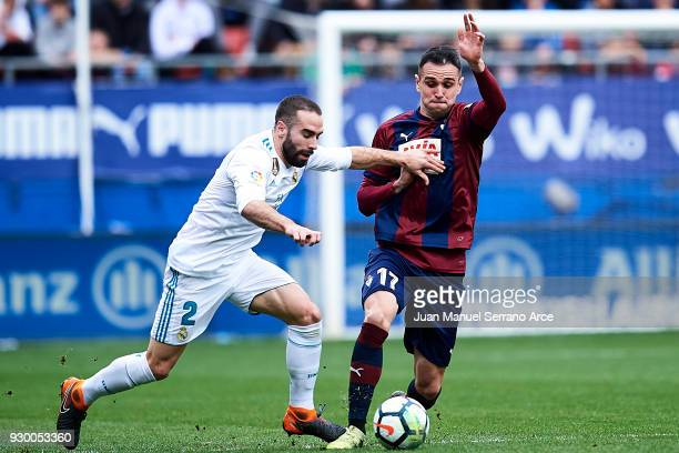 Kike Garcia of SD Eibar duels for the ball with Daniel Carvajal of Real Madrid during the La Liga match between SD Eibar and Real Madrid at Ipurua...