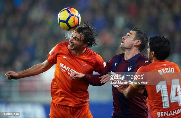 Kike Garcia of SD Eibar duels for the ball with Ignasi Miguel of Malaga CF during the La Liga match between SD Eibar and Malaga CF at Ipurua...