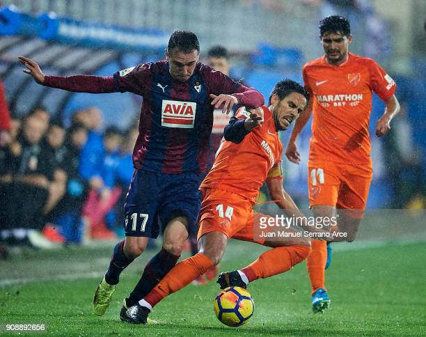 Kike Garcia of SD Eibar duels for the ball with Jose Luis Garcia 'Recio' of Malaga CF during the La Liga match between SD Eibar and Malaga CF at...