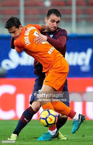 Kike Garcia of SD Eibar duels for the ball with Luis Hernandez of Malaga CF during the La Liga match between SD Eibar and Malaga CF at Ipurua...