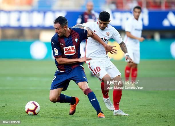 Kike Garcia of SD Eibar duels for the ball with Pablo Sarabia of Sevilla FC during the La Liga match between SD Eibar and Sevilla FC at Ipurua...