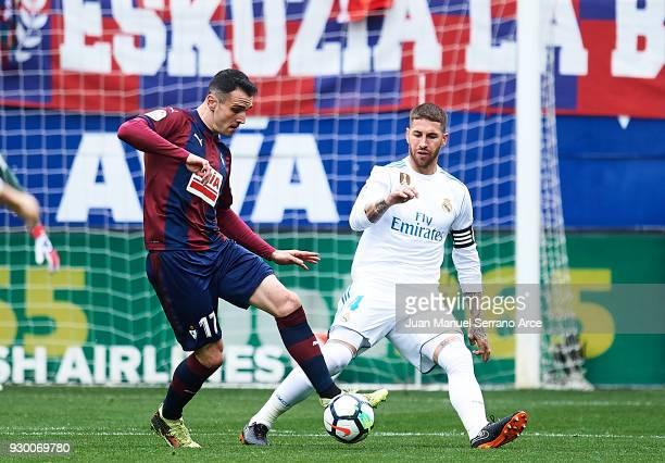 Kike Garcia of SD Eibar duels for the ball with Sergio Ramos of Real Madrid during the La Liga match between SD Eibar and Real Madrid at Ipurua...