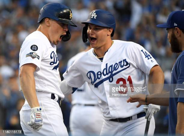 Kike Hernandez of the Los Angeles Dodgers celebrates his solo home run with teammate Joc Pederson to take a 30 lead in the second inning of game five...