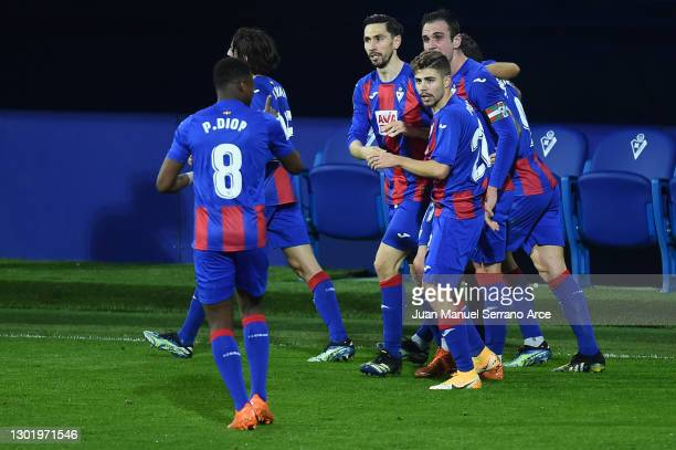 Kike of SD Eibar celebrates with team mates after scoring their side's first goal during the La Liga Santander match between SD Eibar and Real...