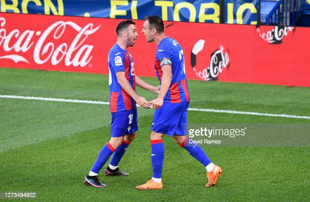 Kike of SD Eibar celebrates with teammates Edu Exposito after scoring his team's first goal during the La Liga Santander match between Villarreal CF...