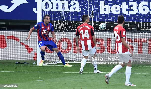 Kike of SD Eibar scores his team's first goal during the La Liga match between SD Eibar SAD and Athletic Club at Ipurua Municipal Stadium on June 17,...