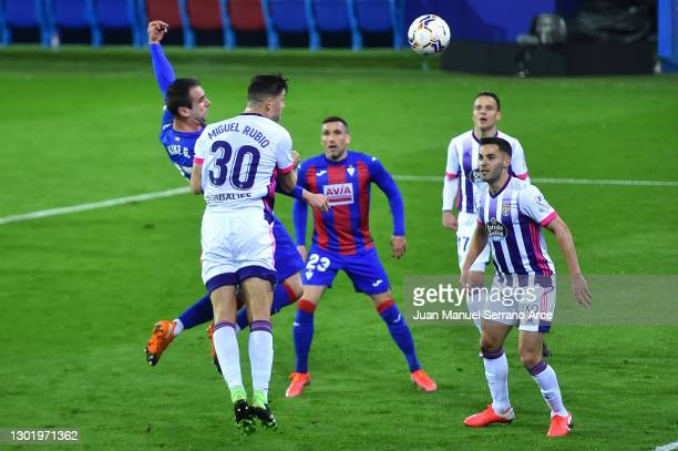 Kike of SD Eibar scores their side's first goal whilst under pressure from Miguel Rubio of Real Valladolid during the La Liga Santander match between...