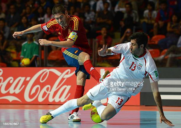 Kike of Spain is blocked by Ahmad Esmaeilpour of Iran during the FIFA Futsal World Cup Group B match between Spain and Iran at Indoor Stadium Huamark...