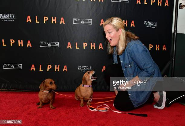 Kiki and Henry pose on the red carpet at the ALPHA Bring Your Own Dog Screening In Boston at Somerville Theater on August 11 2018 in Boston...
