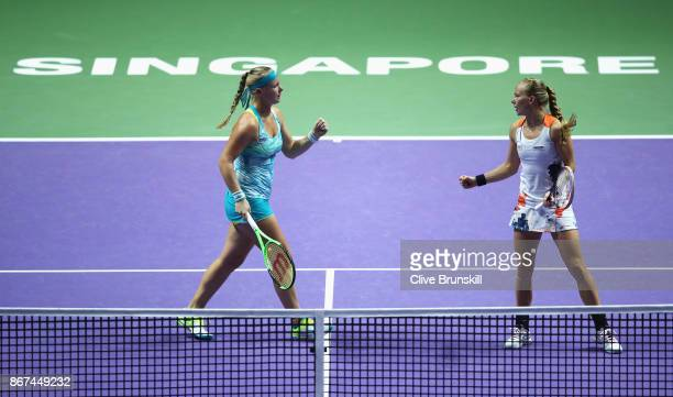 Kiki Bertens of Netherlands and Johanna Larsson of Sweden celebrate a point in the doubles semi final match against Elena Vesnina and Ekaterina...