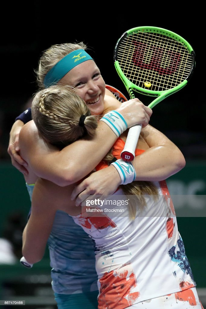 Kiki Bertens (R) of Netherlands and Johanna Larsson of Sweden celebrate victory in the doubles semi final match against Elena Vesnina and Ekaterina Makarova of Russia during day 7 of the BNP Paribas WTA Finals Singapore presented by SC Global at Singapore Sports Hub on October 28, 2017 in Singapore.