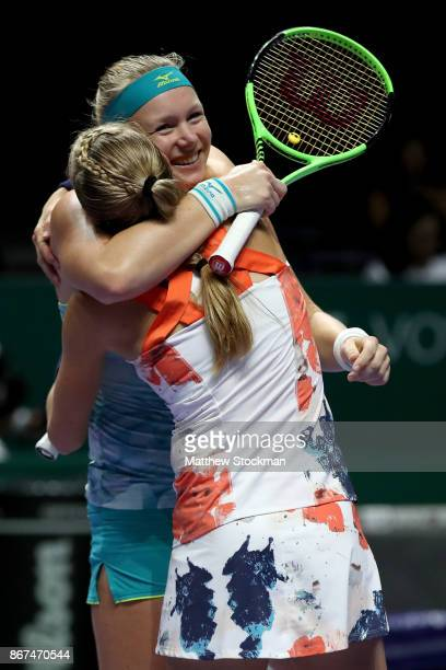 Kiki Bertens of Netherlands and Johanna Larsson of Sweden celebrate victory in the doubles semi final match against Elena Vesnina and Ekaterina...