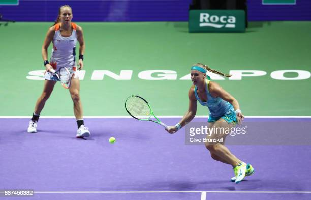 Kiki Bertens of Netherlands and Johanna Larsson of Sweden in action in the doubles semi final match against Elena Vesnina and Ekaterina Makarova of...