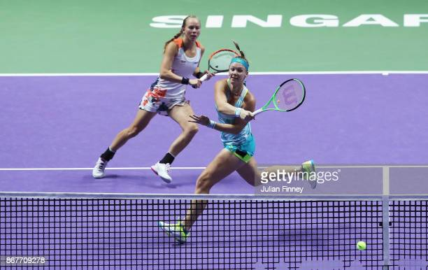 Kiki Bertens of Netherlands and Johanna Larsson of Sweden in action in the Doubles Final against Andrea Hlavackova of Czech Republic and Timea Babos...