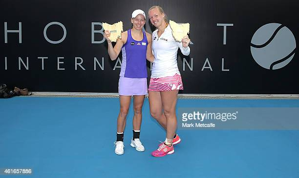 Kiki Bertens of Netherlands and Johanna Larsson of Sweden pose with the winners trophies after winning their doubles final match against Monica...