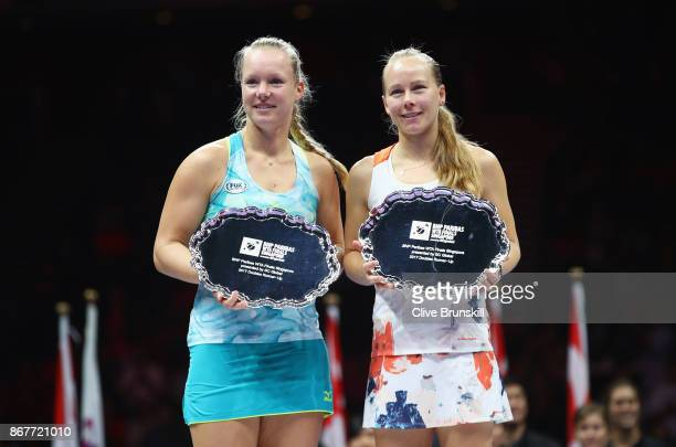 Kiki Bertens of Netherlands and Johanna Larsson of Sweden pose with their runners up trophies after the Doubles Final against Andrea Hlavackova of...