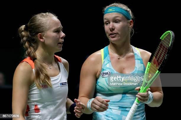 Kiki Bertens of Netherlands and Johanna Larsson of Sweden talk in the doubles semi final match against Elena Vesnina and Ekaterina Makarova of Russia...