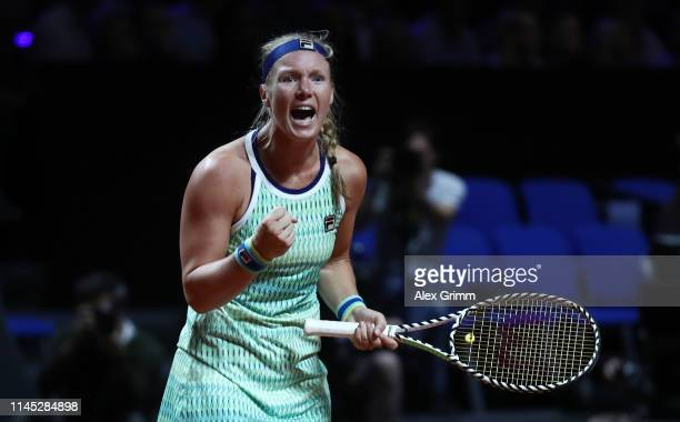 Kiki Bertens of Netherlands celebrates winning her quarterfinal match against Angelique Kerber of Germany on day 5 of the Porsche Tennis Grand Prix...