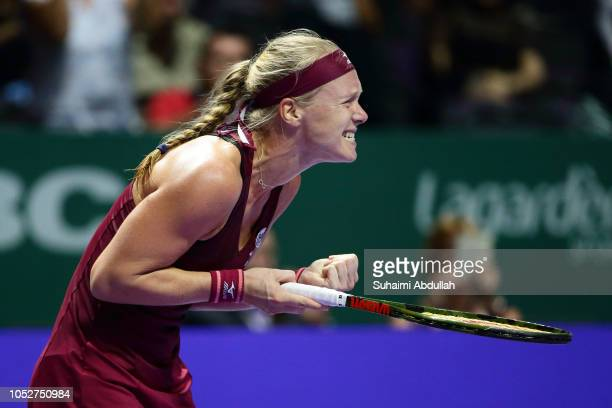 Kiki Bertens of Netherlands celebrates winning her singles match against Angelique Kerber of Germany during day 2 of the BNP Paribas WTA Finals...